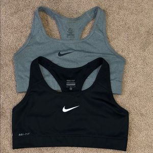 Two pairs of Nike sports bras